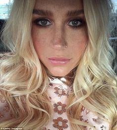 Full make-up: Kesha showcased her pumped up pout and signature full brown brows in this se...