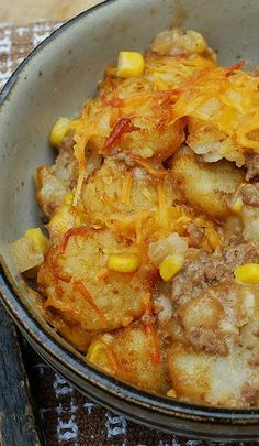 Cowboy Casserole - a basic shepherd's pie with tater tots on top and bottom instead of mashed potatoes.