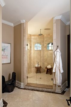 Indianapolis Monthly's 2012 Dream Home: An exclusive look inside the city's premier show home. A crisp color palette of mostly white-and-cream walls and furniture—with splashes of color throughout—complements the builder's architectural design. #bathroom #shower