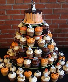 I like the cupcakes with the small cake up top idea