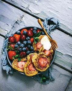 Healthy Pancakes with strawberries baked in! Add coconut oil for extra flavor.