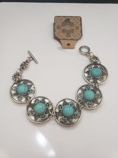 Boutique Item #B346  Hand Crafted Hammered Silver Turquoise Tribal Bracelet  Gift bagged for easy gift giving, Thank you for stopping by and have a blessed day!