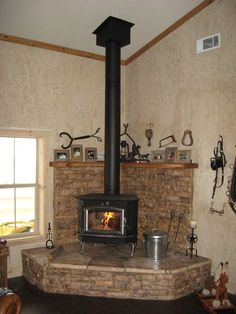 buck stove | Buck stove on large hearth with HT metal chimney