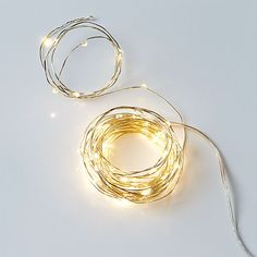 wire sprinkle 21' line lights  way to glow. The sparkle of 60 white LED lights glimmer and shimmer on shapeable silver wire cord. Plug in and light up the party: Coil in a centerpiece bowl, string along the mantel or wrap our wire wreath.