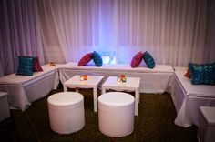 Bridal Bliss Wedding: Modern white lounge with vibrant pillows made with fabric from India