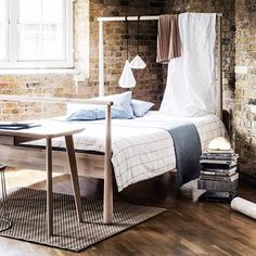 Gjora bed with hanging pendant lamp