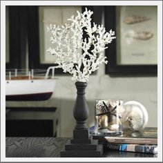 Coral sculpture. Elevate your seaside style. Realistic, textured coral is hand-painted on each side, so you may enjoy the beauty from every angle. Natural wood base is hand turned and carved, then stained a deep ebony for a classic, modern style.