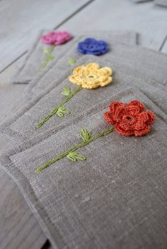 Coasters set made of linen, crochet and embroidery. Either coasters or table mats. I like that there's just a small splash of color. Items similar to Set of 2 coasters from linen/sewing, crocheted and embroidery on Etsy Coasters--no pattern or directions, Crochet Home, Knit Crochet, Hand Embroidery, Embroidery Designs, Embroidery Stitches, Crochet Projects, Sewing Projects, Crochet Flowers, Craft Gifts