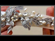 "Video- Pearl and Rhinestone Bridal Ribbon Headband ~ Clarissa - This romantic ribbon bridal headband features a beautiful floral rhinestone and pearl design on a white or ivory ribbon.  This style is also available as a hair comb.  Perfect for the bohemian wedding or any romantic or shabby chic bridal look.  Ornamentation measures approximately 6"" x 2 1/2"" on a 71"" long x 1"" wide ribbon."