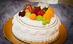 A delicious creamy cake with mixed  fruit toppings to please your taste-buds #indiacakes