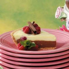"""5 Star!   Two Tone Cheesecake Pie - """"Here's a creamy dessert that is simply luscious. My husband loves it,"""" says Jean Smalls of Cooper City, Florida. """"I'm proud to serve it to company because it always draws raves, I can make it ahead of time, then top with additional berries and chocolate curls just before serving."""""""