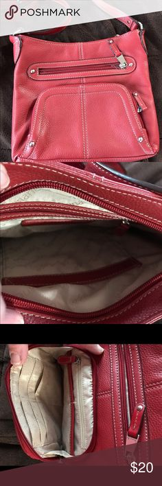 Tignanello cross body Red cross body front zipper pocket , front zipper compartment w/ credit card holders, checkbook fits& 2 slots for keys and phone. Back zipper pocket and inside 1 zipper compartment and 1 pocket. Tignanello Bags Crossbody Bags