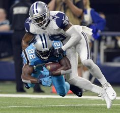 Carolina Panthers' Jerricho Cotchery (82) makes a reception as Dallas Cowboys' Brandon Carr (39) tackles him during the third quarter of their game at AT&T Stadium on Thursday, November 26, 2015. The Panthers won 33-14 and improved to 11-0.