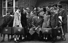 20th March 1956. A group of orphans from a Barnardo's orphanage in London prepare to emigrate to Australia. Comedian Tommy Trinder sees the children off Photo: CORBIS
