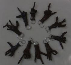 """Harry 8TRX -Each one of these keychains is made with stretched 8 track tape. They range from 3"""". These are my early keychains. They are no longer available. I'm  Always adding new hand signs as I become aware of them."""