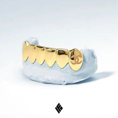 Custom Solid 14K Yellow Gold Bottom 6 Grill with Customized Fang. Create Your Own at www.IFANDCO.com #Grillz #CustomJewelry #IFANDCO