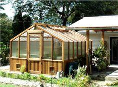 cedar greenhouse right next to carport and rain-catching barrel; convenient.