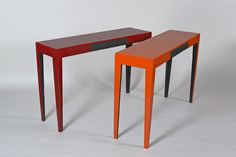 These are the brightly lacquered colours of fire on burnt and charred oak , the idea is that brightness and happiness overcomes adversity , and even tragedy  and because of the backdrop of turmoil the colours have a positivity and depth that could not otherwise be . for these we have developed a method of reconstituting the charred timber , not only are the burnt elements sealed , they are as strong  or even stronger than the unburnt . speaks of life in a sense .