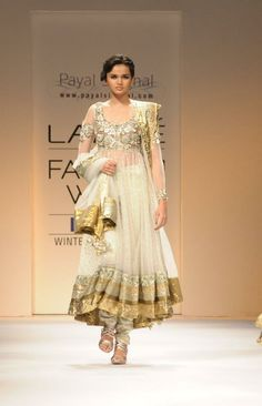 The embellished top on this anarkali makes it perfect for a wedding sangeet. Designer: Payal Singhal