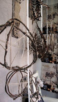 Pia Jane Bijkerk's bookstore window display featuring floral sculptures by Tracey Deep