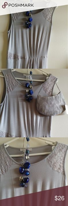 Grey dress Lace on the shoulder and the waist,no waist belt,MIDI and odor free. Make me an offer. Design History Dresses Midi