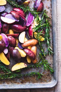 Rosemary Roasted Rainbow Potatoes are a colorful and easy side dish that brings some excitement to the table, and they're no more trouble to make than regular roasted potatoes. #sidedish #rainbow #newpotatoes #roastedpotatoes #easysidedish #dinner #redpotatoes #bluepotatoes #purplepotatoes #recipe #easy Side Dishes Easy, Vegetable Side Dishes, Side Dish Recipes, Sage Recipes, Potato Recipes, Potato Dishes, Vegetarian Recipes, Cooking Recipes, Healthy Recipes