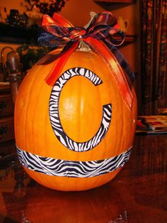 Dress up a pumpkin with duct tape and ribbon