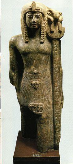 Striding statue of Ramses III as a standard bearer of Amun, dyn. 20, New Kingdom, granite, Karnak temple cachette, Egyptian museum