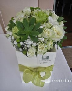 Fioreria Oltre/ Bouquet/ Roses, baby's breath, succulents