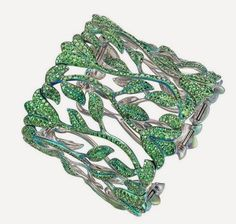 Floral cuff bracelet from the Chopard in titanium, set with 25.48ct green tsavorites