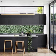 black kitchen, window splashback and window above overhead cabinetry Black Kitchens, Cool Kitchens, Kitchen Black, Charcoal Kitchen, Luxury Kitchens, Kitchen Living, New Kitchen, Long Kitchen, Awesome Kitchen