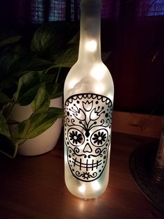 Sugar Skull Wine Bottle Lamp (painted white, frost and sea glass) by PsPrettyPapernGlass on Etsy