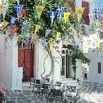 Apparently you can walk along the cobble stone pathways and shop , perhaps stop for an ouzo and mezze . Mykonos Town, Mykonos Greece, Saint Name Day, Stone Pathways, Mykonos Island, Trip Advisor, Street, Holiday Decor, Flags