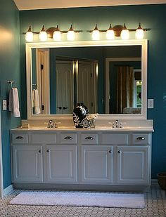 bathroom plate glass mirror framed with molding - Framing the mirror really helped. Must keep in mind for my home