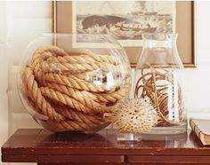 Beach/nautical decor for your beach-inspired room or beach house. Rope in glass jars.