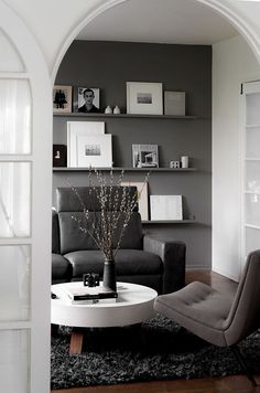 Dark gray den in the house of Minh T via Front and Main