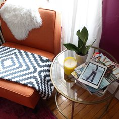 Orange Chair and Gold Side Table