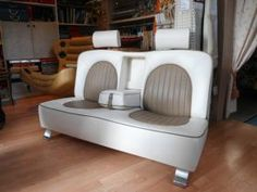 A couch made just like the backseat of a prestigious car, covered in leather, with adjustable headrests and retractable armrests. #artigianato #madeinitaly #car #auto