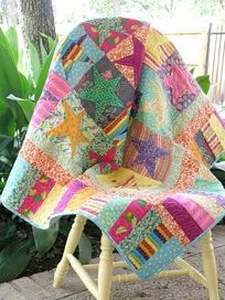 take me to the beach quilt  I wonder if I could do something similar, but use fish fabric for the 'starfish'.