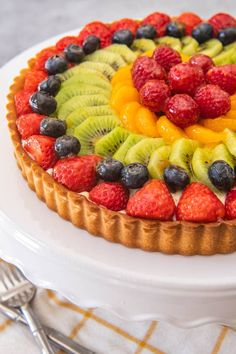 Fresh colorful and bursting with juicy fruit rich pastry cream a deliciously sweet pastry crust and an easy fruit tart glaze this French fruit tart recipe makes a showstopper dessert that is perfect for Spring & Summer! French Fruit Tart Recipe, Fruit Tart Glaze, Fresh Fruit Tart, Juicy Fruit, Easy Fruit Tart Recipe, Tarts Recipe, Mini Fruit Tarts, Fruit Pie, Fruit Flan Recipe