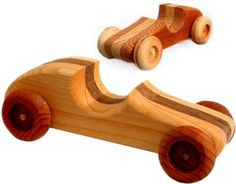 """Handcrafted Wood Race Car - Made in the USA by Taraluna - Fair Trade, Organic & Green Gifts. $20.00. Approx. 8 1/4"""" long, 3"""" tall, 4"""" wide. Handcrafted in the U.S.A.. This beautiful toy is kid tough and safe - no need to worry about lead, or toxic chemicals.. Handcrafted wooden race car will offer lots of imaginative play time.. Beautiful craftsmanship and love goes into each of these products.. Made in the USA from a variety of woods, each one is handmade and unique..."""