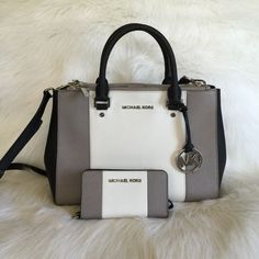 MK Color block sutton with wallet Authentic Michael Kors bag and matching wallet.  It's medium sized sutton satchel in black white and grey color block.  The hardware is silver.  Great condition. Will trade for another handbag/wallet set.    Comes with shoulder strap. Michael Kors Bags