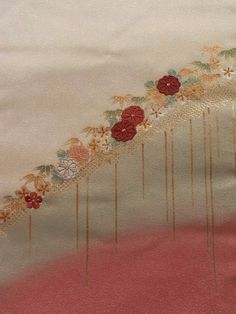 This is a graceful nagoya obi with lovely 'kiku' (chrysanthemum) and 'shou-chiku-bai' (auspicious 'three friends of winter' motif - pine tree, bamboo and ume blossom) pattern, which are neatly used press-foil technique and embroidered. Interwoven metallic yarns make it look gorgeous. Textile is exquisite soft silk, but has slightly stiff touch.