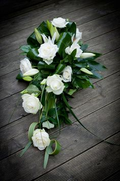 Ivory rose funeral spray