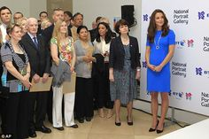 Kate listens to a speech during her visit to 'Road to 2012 : Aiming High' exhibition at the National