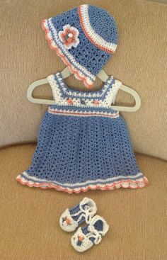 Crocheted baby dress with matching shoes and hat