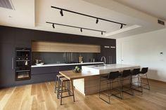 Architecture: Modern Black And White Kitchen Design With Large Island Plus Metal Barstools Feat Unique Track Lighting: Peeking inside in Australia New Neighborhood Architecture