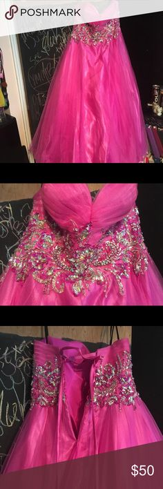 A big pink princess gown perfect for prom! Full length corset back ball gown. Perfect condition and only worn once! Beautiful flower detail with sequins and lots of shimmer! Dresses Prom