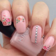 For something as detailed as a rose, a nail decal used correctly creates a great result, like in this roma...