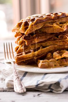 Simple Pumpkin Waffles Recipe - No fuss around this breakfast! Straight forward pumpkin is nicely spiced up to make up the most delicious waffles for fall!